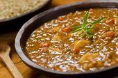 stock photo of vegetable soup  - Close up of a bowl of hearty lentil soup with potatoes and carrots - JPG