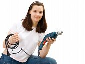 The Young Girl With Building Drill In Hands