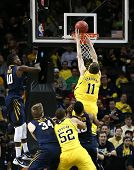 BROOKLYN-DEC 15: Michigan Wolverines guard Nik Stauskas (11) dunks the ball past West Virginia Mount