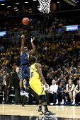 BROOKLYN-DEC 15: West Virginia Mountaineers guard Juwan Staten (3) shoots over Michigan Wolverines g