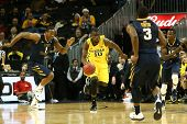 BROOKLYN-DEC 15: Michigan Wolverines guard Tim Hardaway Jr. (10) dribbles the ball against the West
