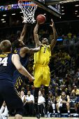 BROOKLYN-DEC 15: Michigan Wolverines forward Glenn Robinson III (1) shoots as West Virginia Mountain