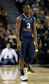 BROOKLYN-DEC 15: West Virginia Mountaineers guard Juwan Staten (3) reacts on the court against the M