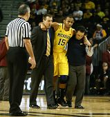 BROOKLYN-DEC 15: Michigan Wolverines forward Jon Horford (15) is escorted off the court after an inj