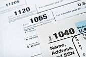stock photo of time-saving  - U.S. Income Tax Return forms 1040 1065 and 1120