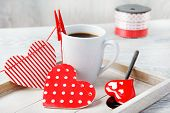 Hearts pinned to coffee cup