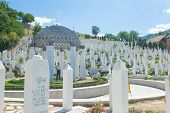 SARAJEVO, BOSNIA - AUGUST 12, 2012: Muslim graveyard under blue sky in Sarajevo on August 12, 2012 i