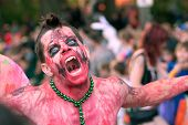 Zombie Makes Scary Face In Halloween Parade