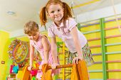stock photo of physical education  - Cute happy children playing in kindergarten gym - JPG