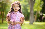 Portrait Of Hispanic Girl In Sunny Park