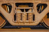 stock photo of boxcar  - Wheels and springs of freight train boxcar on railroad tracks Sterling Colorado - JPG