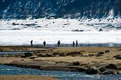 Fishermen In A Mountain Dam Lake In Spring