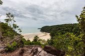 A Deserted Beach Surrounded By Tropical Jungle