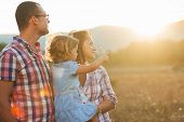 stock photo of happy day  - Happy family having fun outdoors and smiling - JPG