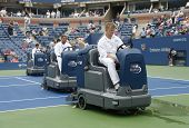 S Open cleaning crew drying tennis court after rain delay at Arthur Ashe Stadium at US Open 2013