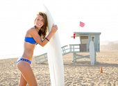Beautiful surfer teen girl with surfboard in Santa Monica beach California Lifeguard house [ photo-illustration]