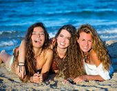 Girls group friends having fun happy lying on the beach sand shore