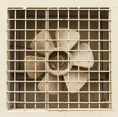 Extractor fan propellers behind metal grid