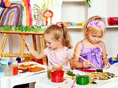 stock photo of nursery school child  - Child painting at easel in school - JPG