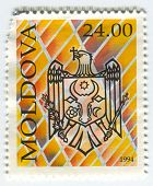 MOLDOVA - CIRCA 1994: A stamp printed in  Moldova  shows image of the Coat Of Arms, circa 1994.