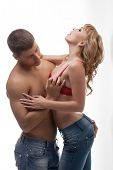 Passionate lovers caress each other in studio