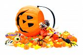 stock photo of jack-o-lantern  - Halloween candy spilling from a Jack o Lantern holder - JPG