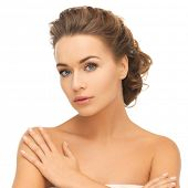 health and beauty concept - face and hands of beautiful woman with updo (can be used as a template f