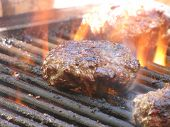 stock photo of meatloaf  - a tasty meatloaf on a flaming grill