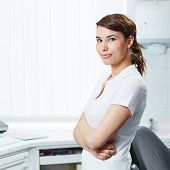Portrait of an attractive dental assistant with her arms crossed in dental practice