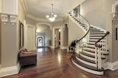 stock photo of entryway  - Foyer in traditional suburban home with curved staircase - JPG