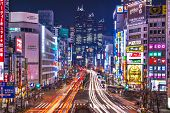 TOKYO, JAPAN - JANUARY 9, 2013: Traffic passes through the Shinjuku District. The district is the main commercial and administrative center of the city.
