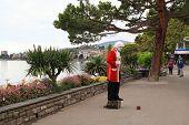 Street Performer Standing Imitating Statue Of Mozart, Swizerland