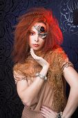 picture of woman dragon  - Young  ginger woman in artistic image and with artistic visage - JPG