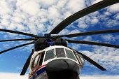 stock photo of rescue helicopter  - Large multipurpose helicopter parked at the airbase - JPG