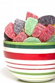 Holiday gumdrop candy in a variety of colors and flavors in a festive bowl