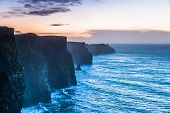 stock photo of ireland  - Famous cliffs of Moher at sunset in Co - JPG