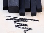 Black drawing charcoals on paper