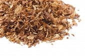 Close up of dried pipe tobacco isolated on white