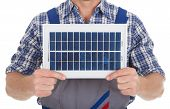Manual Worker Holding Solar Panel