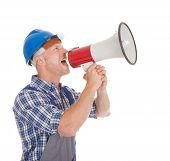Manual Worker Speaking Into Megaphone