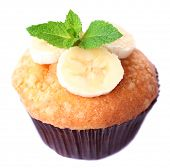 Tasty banana muffin isolated on white