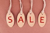 Sale tags on brown background