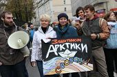 Boris Beilinson, Evgeniya Chirikova and unknown protesters in support of the Arctic Sunrise