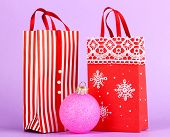 Christmas paper bags for gifts on purple background