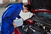 Mechanic Pouring Antifreeze Into Windscreen Water Tank