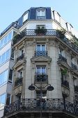 PARIS, FRANCE - NOVEMBER 04, 2012: Facade of a traditional apartment building in Paris, France on November 04, 2012