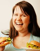 fat white woman having choice between hamburger and salad