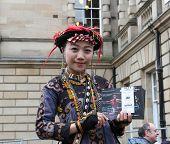 EDINBURGH- AUGUST 16: Member of Tjimur Dance Theatre publicize their show Kurakuraw Dance Glass Bead during Edinburgh Fringe Festival on August 16, 2014 in Edinburgh Scotland