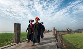 MANDALAY, MYANMAR - JAN 19, 2014: Unidentified Burmese women in traditional clothes visiting U Bein