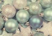 Festive Background Of Aqua Torquiose Pale Blue Christmas Glitter Baubles And Stars On A Pale Aqua Bl